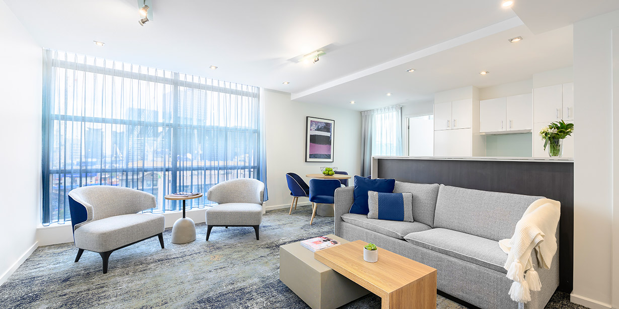 adina-apartment-hotel-northbank-two-bedroom-lounge-room-02-2018
